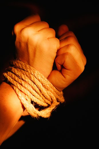 Stock Photo: 1889R-2409 Wrists bound by rope