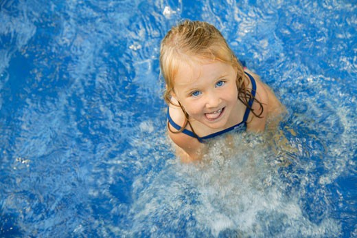 Child in swimming pool : Stock Photo