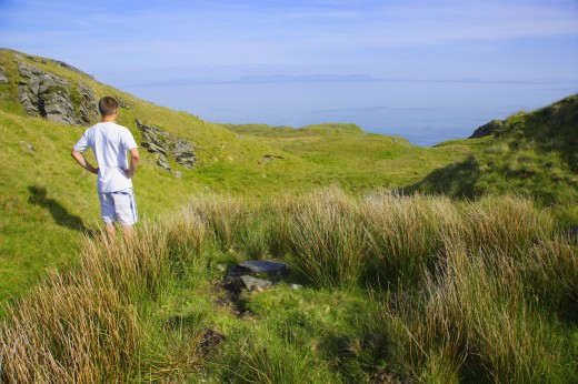 Stock Photo: 1889R-24192 Man standing on a hillside in Ireland