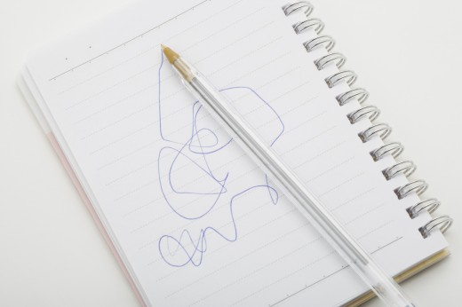 Scribbles in notebook : Stock Photo