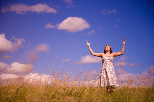 Women with arms raised in worship : Stock Photo