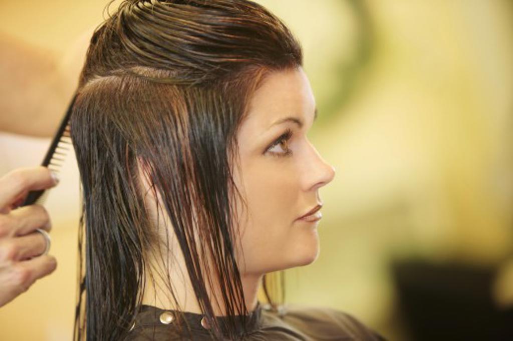 Woman having her hair cut : Stock Photo