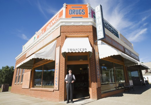 Stock Photo: 1889R-25069 Man in front of historical drugstore