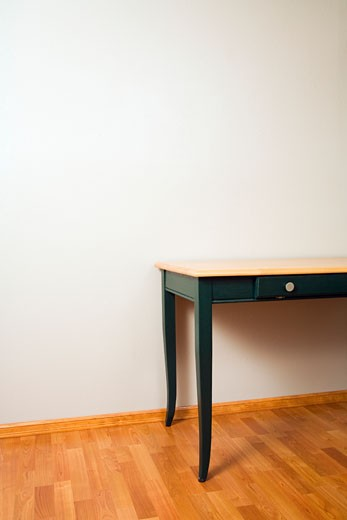Table on hardwood floor : Stock Photo