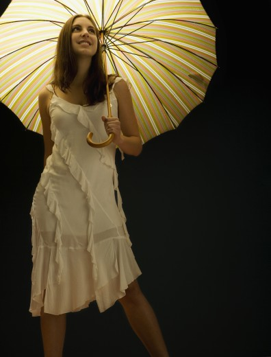 Young woman with umbrella : Stock Photo