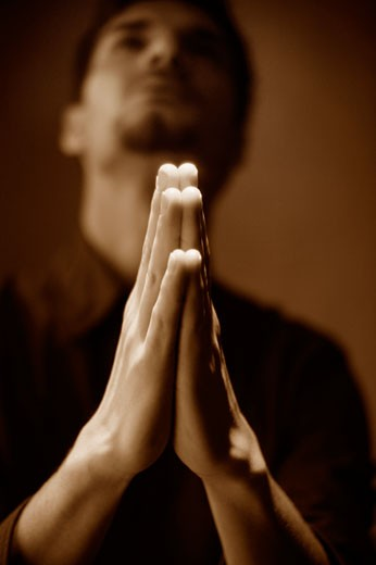 Stock Photo: 1889R-2778 Man praying