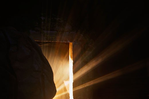Stock Photo: 1889R-28009 Light emerging from behind a tombstone