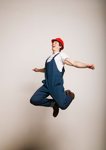 Tradesmen jumping : Stock Photo