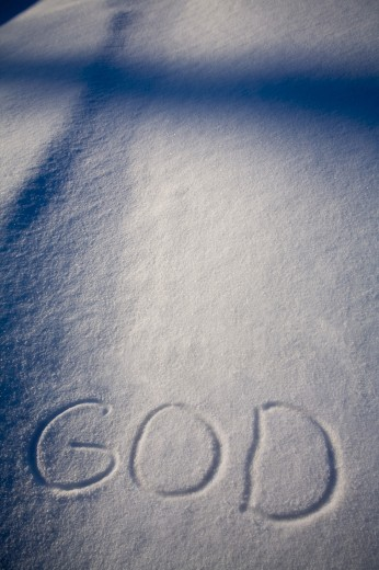 Stock Photo: 1889R-28665 God written in the snow and a shadow of a cross