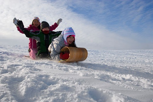 Children tobogganing : Stock Photo
