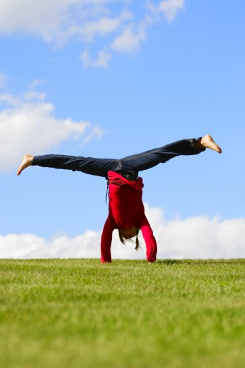 Girl doing a handstand : Stock Photo