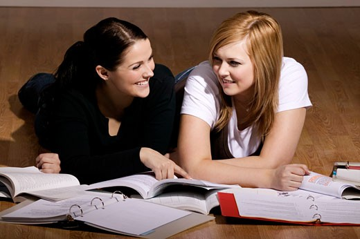 Stock Photo: 1889R-29694 Two women studying on the floor