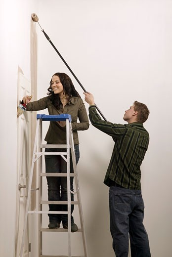 Couple painting the wall : Stock Photo