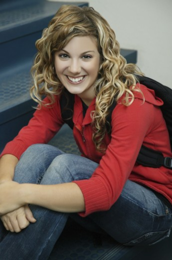 Stock Photo: 1889R-30185 Smiling girl sitting on stairs