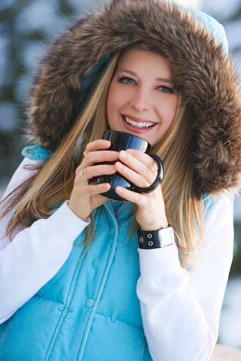 Woman drinking hot drink outside : Stock Photo
