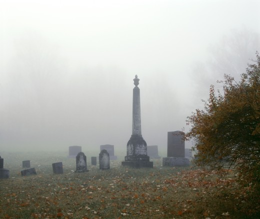 Stock Photo: 1889R-30436 Cemetery with tombstones in the fog