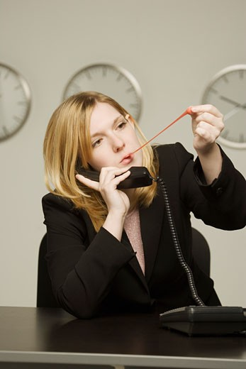 Stock Photo: 1889R-30606 Woman disinterested in work