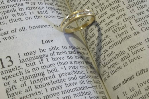Stock Photo: 1889R-30736 A wedding ring on an open Bible