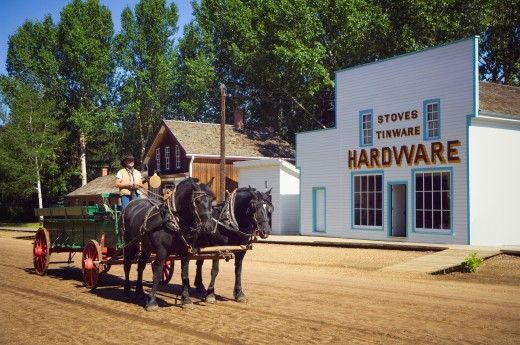 Fort Edmonton Park, horse team and wagon pass historic hardware store    : Stock Photo