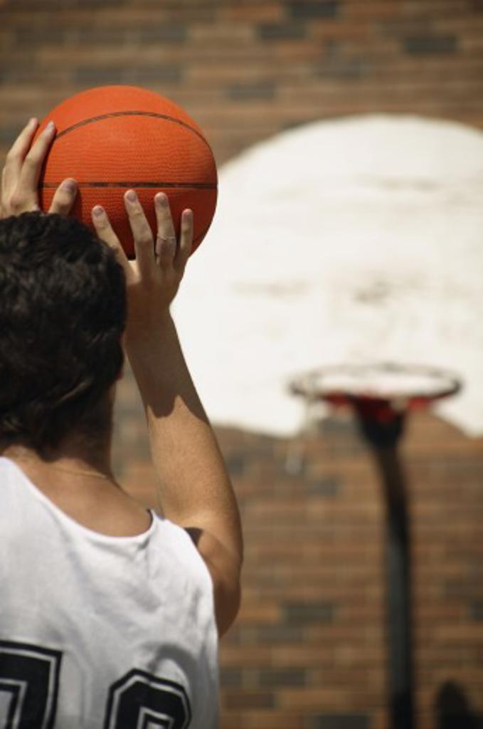 Basketball player taking aim : Stock Photo