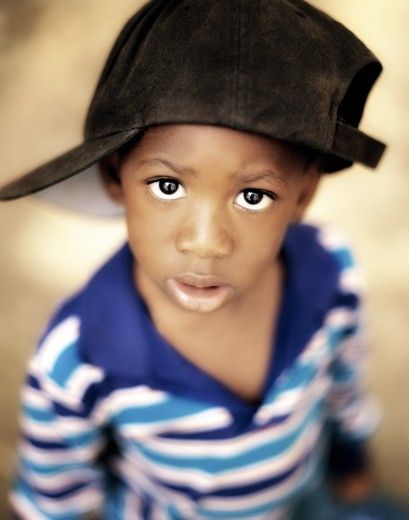 Stock Photo: 1889R-31400 Boy wearing over sized hat sideways
