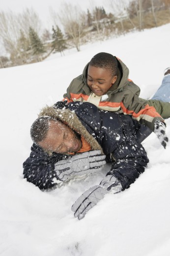 Stock Photo: 1889R-32425 Father and son playing on snow