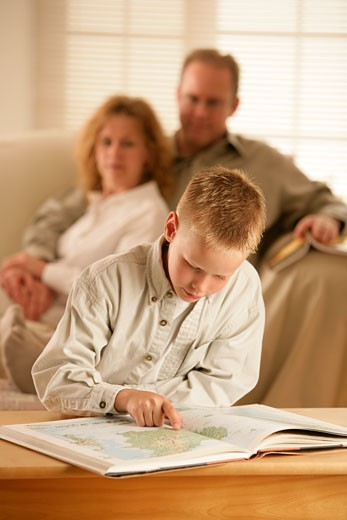 Stock Photo: 1889R-32752 A boy looking at an atlas