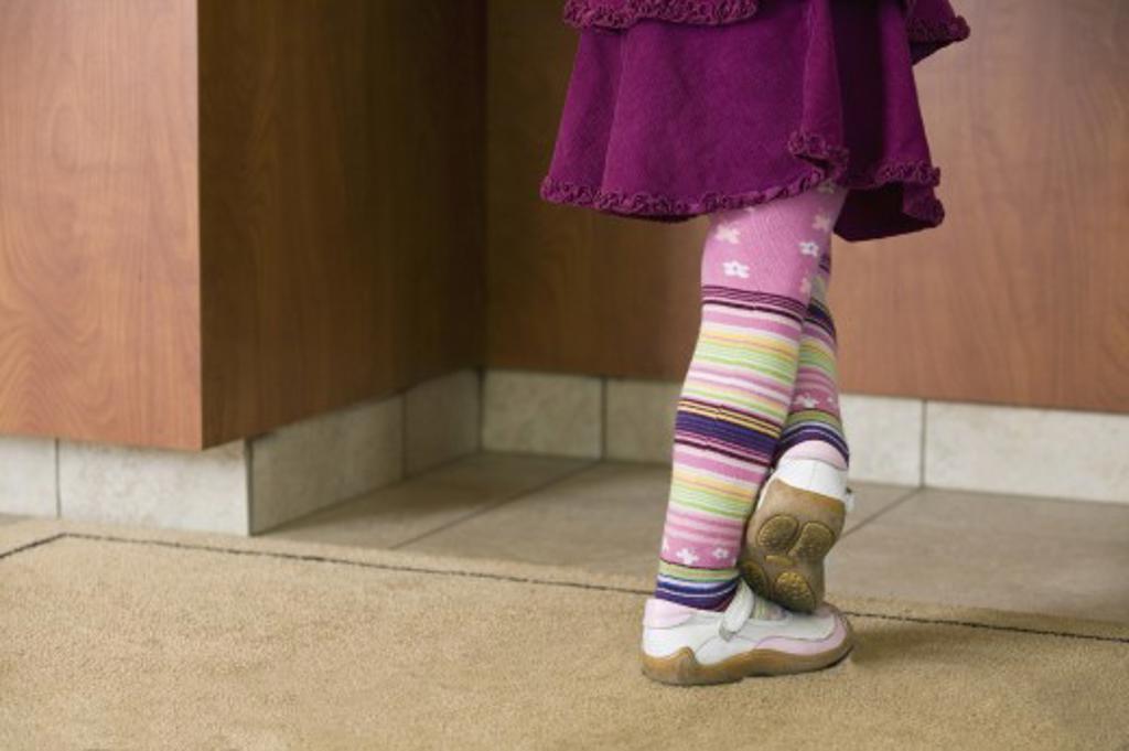 Stock Photo: 1889R-32930 Little girls legs
