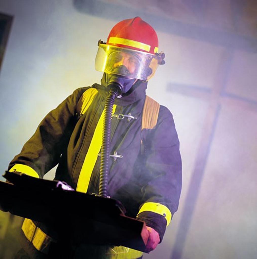 A firefighter giving a speech : Stock Photo