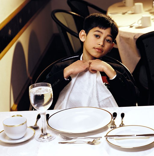 A boy ready to eat a formal dinner : Stock Photo