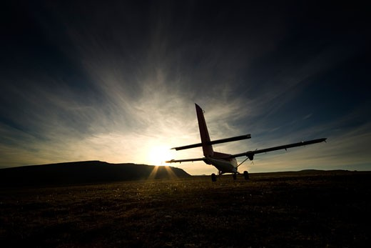 Small aircraft silhouette : Stock Photo