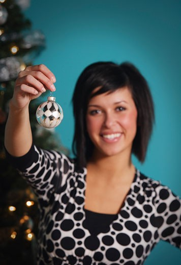 Woman holding Christmas ornament : Stock Photo