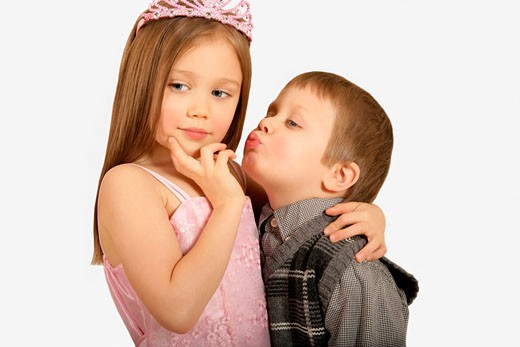 Boy trying to kiss princess : Stock Photo