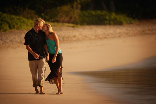 Romantic walk along the beach : Stock Photo