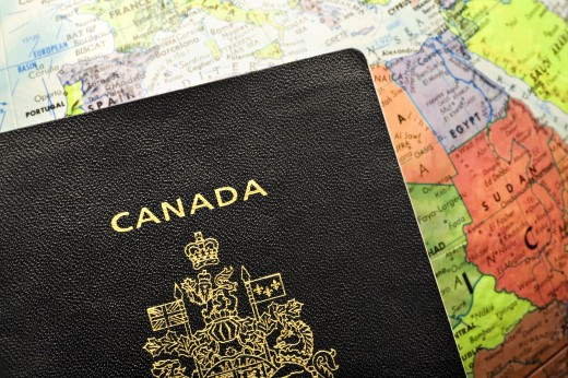 Canadian passport laid over a map of Africa : Stock Photo