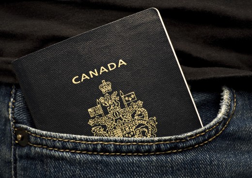 Stock Photo: 1889R-35469 Canadian passport in a pocket