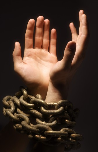 Chained hands : Stock Photo