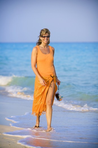 Stock Photo: 1889R-35593 Woman walking on the beach, Playa del Carmen, Mayan Riviera, Mexico