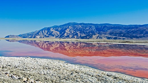 Stock Photo: 1889R-35730 A mountain reflection in the algae of Owens Lake, California, USA