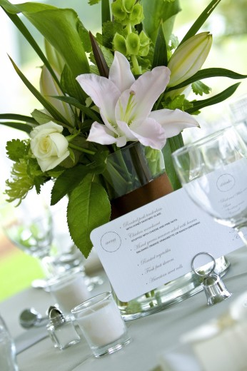 Menu card on table next to flower vase : Stock Photo