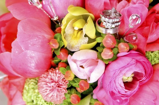 Wedding rings in bouquet : Stock Photo