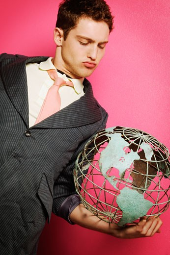 Young businessman with globe in hand : Stock Photo