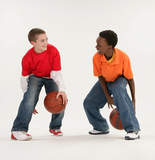 Stock Photo: 1889R-36825 Two boys playing basketball