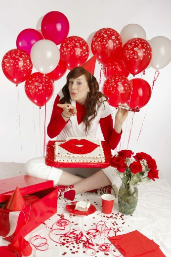 Lady with red balloon's and a cake : Stock Photo