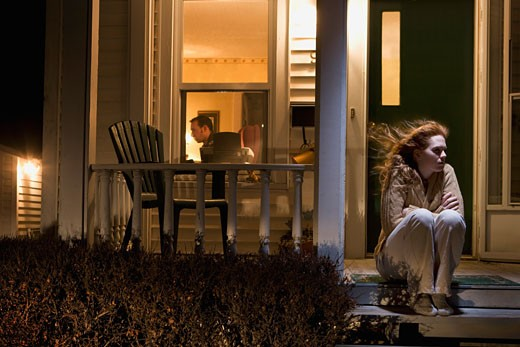 Stock Photo: 1889R-36919 Woman sitting outside of her house