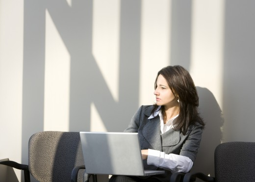 Woman sitting with laptop : Stock Photo