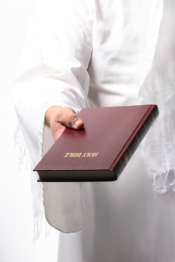 Jesus holding the Bible : Stock Photo