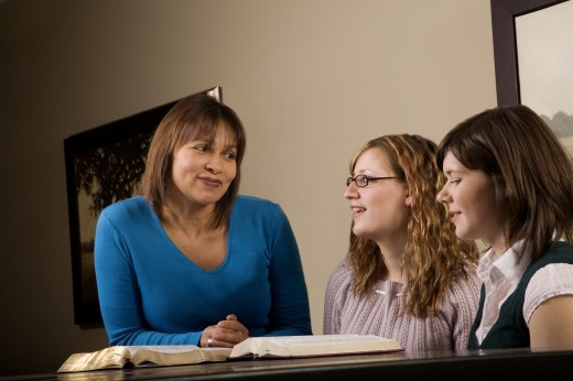 Stock Photo: 1889R-37933 Three women discussing a book