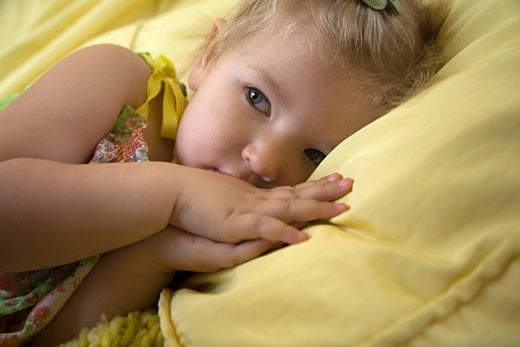 Stock Photo: 1889R-37943 A girl lying in bed