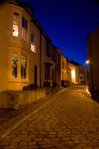 Stock Photo: 1889R-37988 Narrow Cobblestone Road At Night